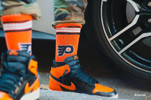 Sports socks and shoes, standing in front of a car - gifts for football fans