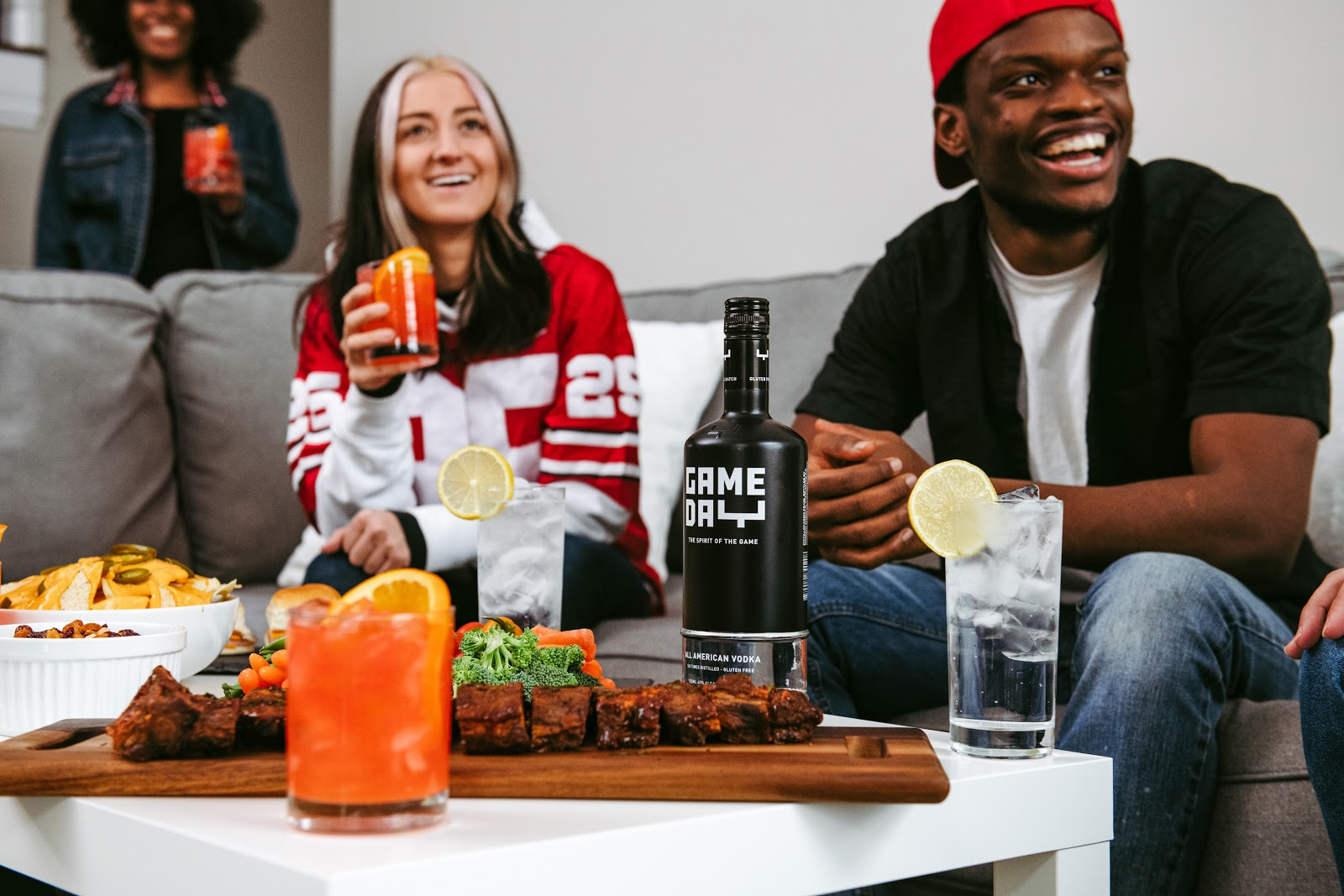 Fans watching with Tampa Super Bowl Drink in hand