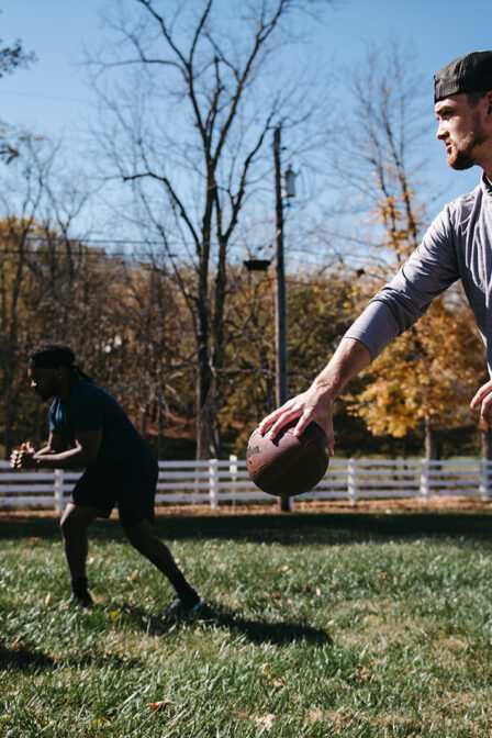 Father and Son Play Football